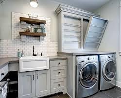 Farmhouse laundry room with custom drying rack, subway tile backsplash,  open shelves and farmhouse