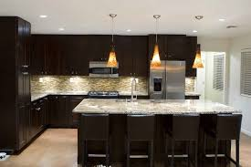 cheap kitchen lighting ideas. Glossy-sectional-cabinet-storage-overlooking-white-granite-countertop- Cheap Kitchen Lighting Ideas C