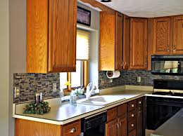 kitchen astounding mosaic pattern ceramics glass tiles backsplashes featuring brown wooden kitchen cabinets and white