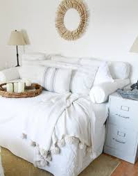 Queen bed turned Sofa-Style DaybedsLove how Annie took a queen mattress,  stuffed the back cushions from an Ikea slipcover and used bolster pillows  to create ...