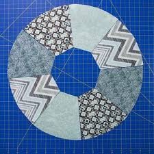 easy steps to perfect wagon wheel quilt blocks & Position pieces in layout before sewing Adamdwight.com