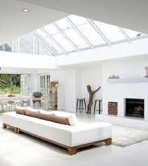 All White Rooms: Natural wood accents add warmth to this sleek modern all  white living