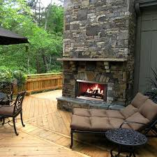 dark stone outdoor fireplace