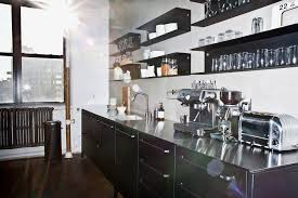 A Vipp kitchen in Brand New School, a creative agency on Varick Street in  Manhattan. The kitchens come in one color, black, and are embedded with  appliances ...