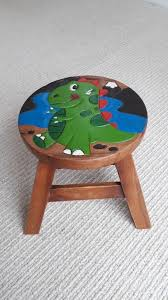 funky solid wooden stool with hand painted dinosaur