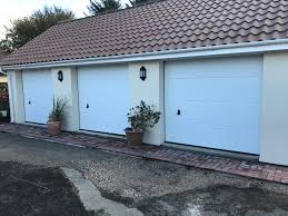 white l ribbed hormann sectional garage doors in looe