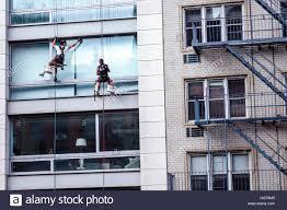 bosun chair window washing. manhattan new york city nyc ny chelsea building window washer man cleaning glass windows dangerous job boatswain\u0027s chair bosun\u0027s rope descent sy bosun washing