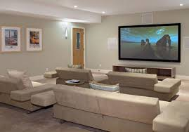 home theater living room. a modern cool living room theaters with perfect grey sofa set and big tv wall home theater