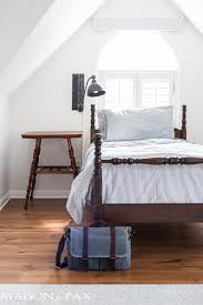 antique bed vintage accordion sconce shiplap walls vintage school desk as bedside table