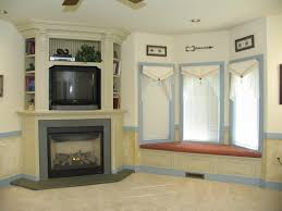 corner fireplace mantels above surrounds