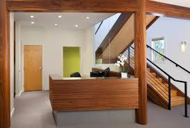 office remodel. Walnut Reception Desk Beams And Columns Office Remodel