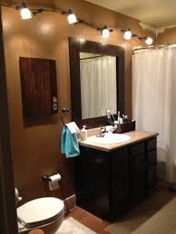 java gel stain over oak cabinets with a java trimmed mirror refurbished cine cabinet and track lighting my bathroom java gel stains