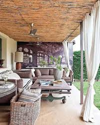 Patio curtains incredible coffee table and comfortable furniture brings a whole new meaning to an outdoor livingroom