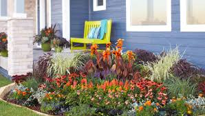 front yard flower garden plans. corner flower bed with colorful blooming perennials and annuals front yard garden plans