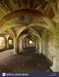 Spectacular and ornate arched ceiling of cloisters at ruins of historic  Lanercost priory in Cumbria England