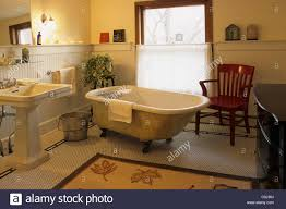 Old Fashioned Cast Iron Clawfoot Bathtub And Pedestal Sink In