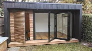 garden office with shed. garden room with contrasting cedar cladding and bi-fold doors decking office shed o