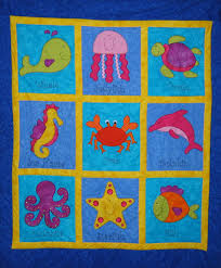 Lynnie Ree's Patchwork Designs: Under The Sea Quilt! & Animals from Under The Sea, are so nice and bright that I just had to use  them for one of my designs! Adamdwight.com