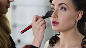 makeup artist doing makeup with black hair in a beauty salon hd stock video