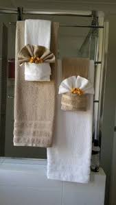 Image Towels Decoratively Towel Folding Bathroom Decor Hanging Bathroom Towels Folding Bathroom Towels Decorative Bathroom Towels Pinterest 57 Best Towel Display Images Ideas Window Displays Product Display
