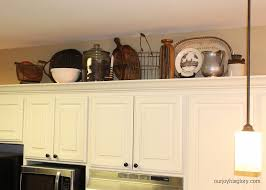 decorating above kitchen cabinets unique cabinet ideas on top of