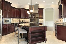 cherry cabinet kitchen designs. Simple Designs Imposing Dark Wood Island With Black Countertop Dominates This Kitchen  Featuring Brushed Aluminum Appliances And Cherry Cabinet Kitchen Designs O