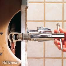 how to fix a leaking bathtub faucet the family handyman regarding new bathtub faucet