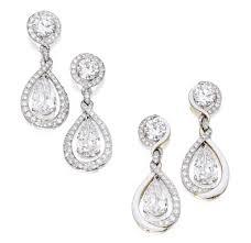 pair of diamond pendant earrings with three interchangeable diamond and enamel earring jackets the earring jackets by david webb 2