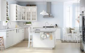 white kitchen. a large white kitchen with lot of drawers, wall cabinets and island