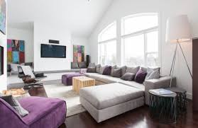 modern living room in grey with a balanced addition of purple in contemporary living room with purple flowers balanced living room