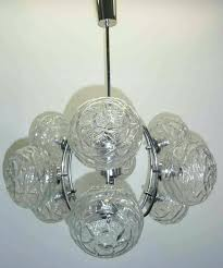 this mid century modern chandelier was made in the it is glass bulb light covers id f