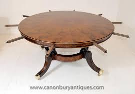 regency extending jupes dining table in walnut round tables