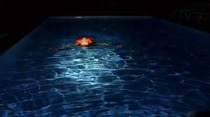 pool water at night. Pool Water At Night. Perfect Night Young Woman Swims In The On Her Back O