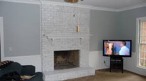 white wash brick fireplace with gray paint