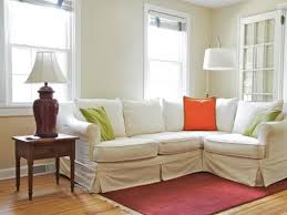 small apartment size furniture. L Shaped Sectional With White Slipcover And Fun Colored Accent Pillows Red Rug Vintage Styled Side. Pretty Blue Apartment Size Small Furniture