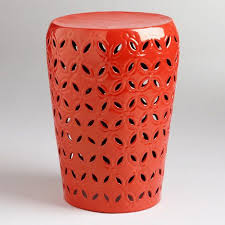 patio stool: orange lili punched drum stool world market