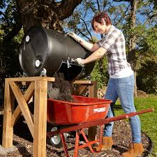 rotate the compost tumbler daily the bung caps into the holes to prevent compost from leaking out then grab the handles and rotate the drum several
