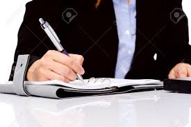 Business person writing in a daily organizer Stock Photo - 13025674