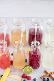 8 bottles of flavored water with a straw