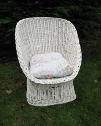 white wicker chair. Classic Shaped White Wicker Chair