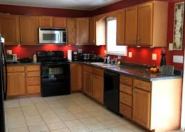 Oak Kitchen Cabinets And Wall Color Red And Brown Kitchen Decor Kitchen And Decor