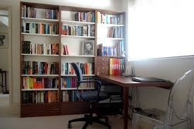 bespoke home study with desk and shelves in walnut