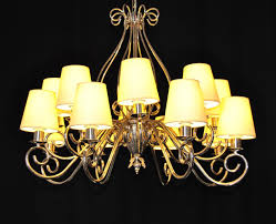 the custom made silver tubular chandelier with yellow 12 lampshades