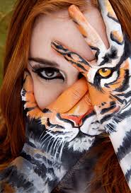 makeup artist realistically paints her hands to reveal a tiger s stare