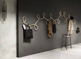 This modular wooden coat hanger is inspired by the ballroom dance, the  Waltz.