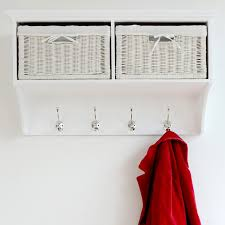 Decorations:Calming Metal Coat Hooks Design With White Wicker Storage  Baskets And White Paint Wall