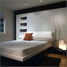 Small Basement Bedroom Attractive Dark Bed And White Bedding In Small Basement Bedroom
