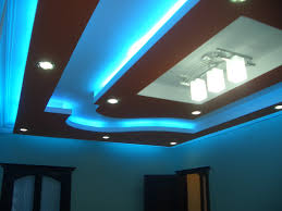 modern living room pop ceiling design with blue led lights and 3 white hanging lamp plus