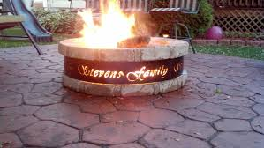 custom metal fire pit with round stoned fire pit and brick pattern tiles