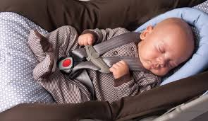 baby with a newborn car seat insert